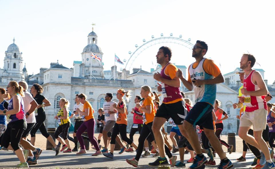 Runners running past the london eye