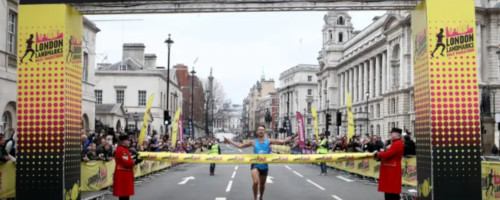First runner crosses the London Landmarks Half Marathon 2018 finish line.
