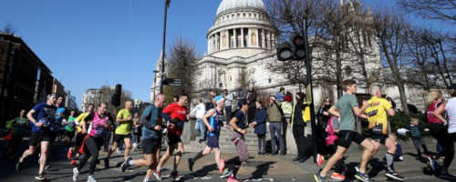 Runners passing St. Pauls at the London Landmarks Half Marathon