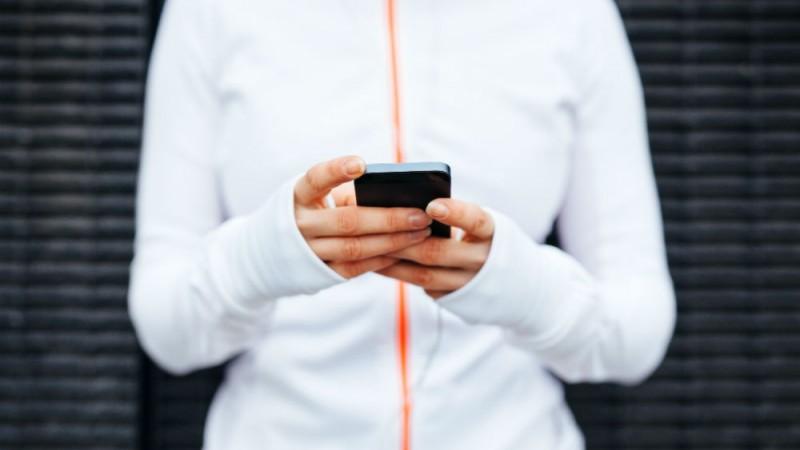 Woman in running gear with phone