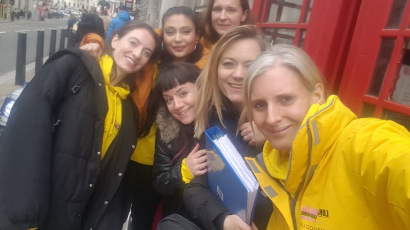 The LLHM team by a phone box