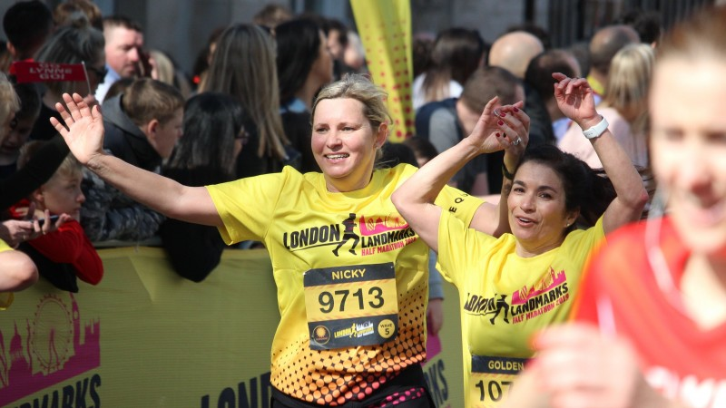 Two runners wearing the official London Landmarks Half Marathon technical T-shirt