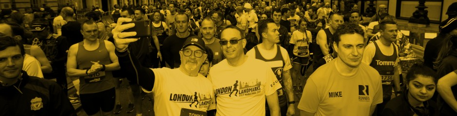 Two men taking a selfie in LLHM T-shirts